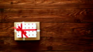 Hands piled a hip of present boxes over wooden flat lay video
