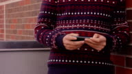 Hands playing on Cell Phone video