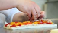 hands prepare a sandwich with peppers and tuna video