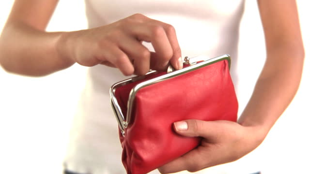 Hands putting coin in red purse video