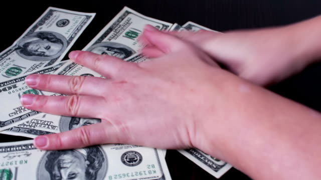hands quickly take Hundred dollar bills video