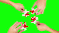 Hands solving a puzzle. Green Screen and Wood. Stop sign. video