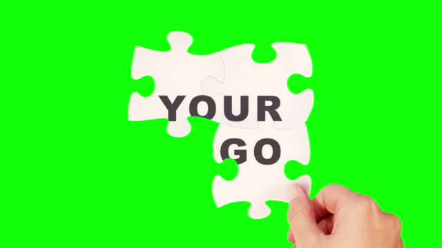 Hands solving a puzzle. Tracking points. Your logo. Close up. video