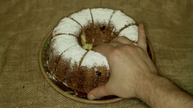 Hands take home made cake video