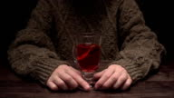 Hands twisting and sharing mulled wine video