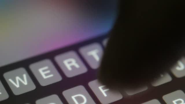 Hands typing on smartphone video
