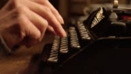 LD hands typing on the typewriter video