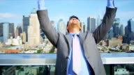 Hands up of Caucasian smart male celebrating business success video
