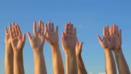 Hands up on blue sky background video