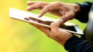 Hands using digital tablet computer, Slow motion video