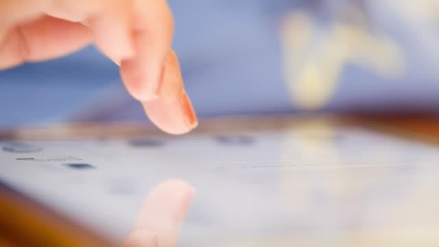 Hands using digital tablet (Ipad) video