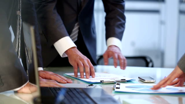 Hands with business documents at meeting video
