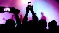 hands with smartphones video
