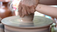 Hands working on pottery wheel video