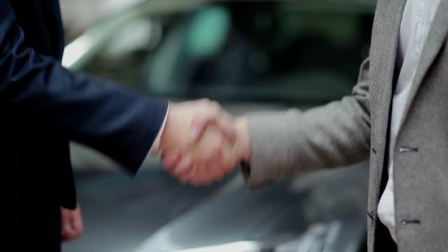 Handshake and handing over the keys video