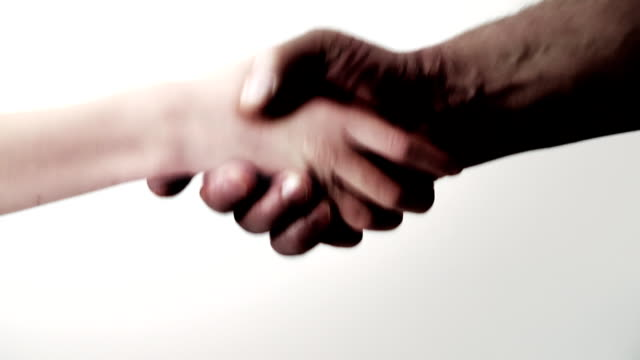 Handshake. Black and white. Reconciliation. Friendship. video
