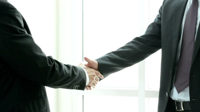 Handshake of businessmen - greeting,dealing & appreciation concepts video