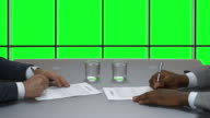 Handshake of businessmen on the background of a green window. video