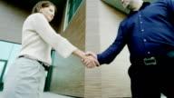 handshake of man and woman video