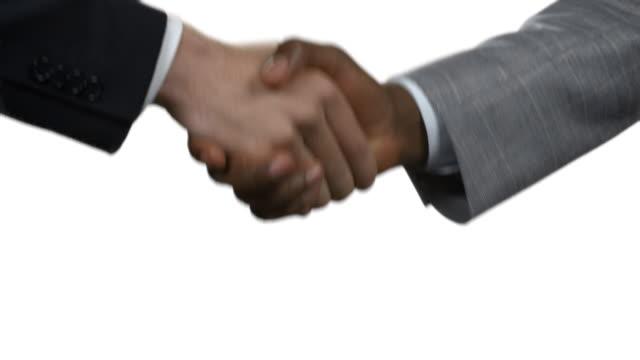 Handshake of men on a white background. video