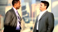 Handshake of multi ethnic  managers talking business strategy on rooftop video
