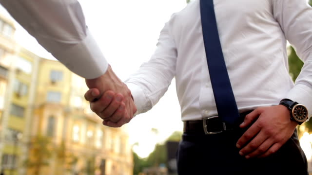 Handshake of two businessman video