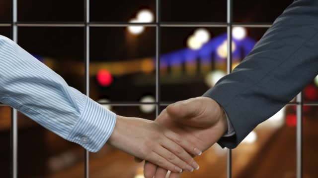 Handshake of two colleagues. video