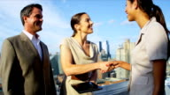 Handshake on business meeting diverse management team using touch screen video