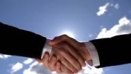 Handshake over the sun video
