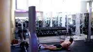 Handsome athlete doing burpees in the gym video
