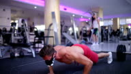 Handsome athlete doing burpees in the gym while wearing Elevation Training Mask video