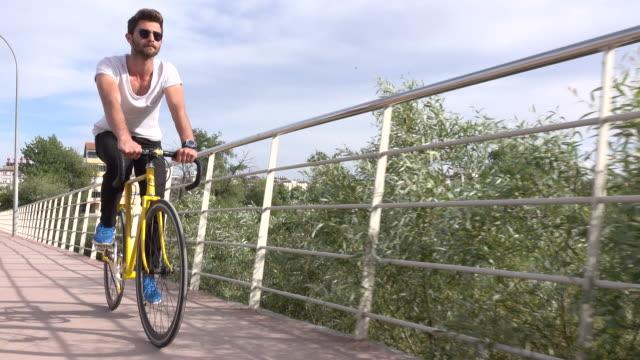 Handsome boy ride a bike video