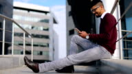 Handsome business man using smart phone video