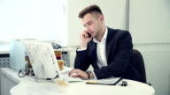 Handsome businessman has bad news by phone video