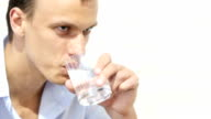 Handsome businessman in casual cloth  drinking water in office video