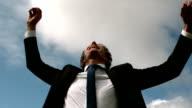 Handsome businessman put his hands up video