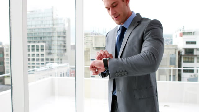 Handsome businessman using his smart watch video