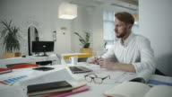 Handsome businessman working at the office and looking at photo frame video