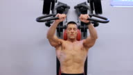 Handsome fit sporty man doing exercises... video