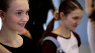 Handsome girls prepare for photoshoot in white studio video