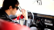 Handsome male model posing in car video