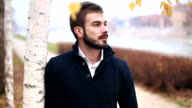 Handsome male walking and posing outdoor video