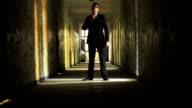 Handsome Man in Suit Confident Look Dark Tunnel HD video