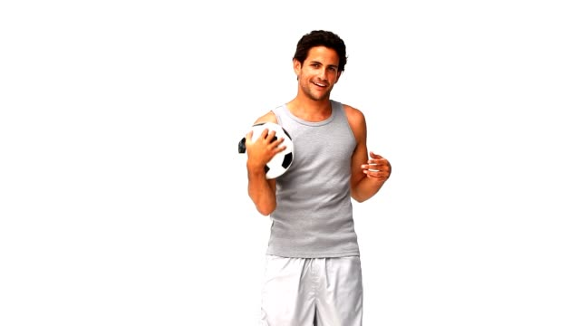 Handsome man playing with a soccer ball video