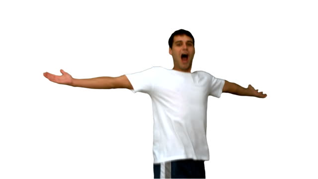 Handsome man turning and raising arms on white screen video