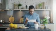 Handsome Man Unfolds Letter. He Got Good News and Starts Dancing. video