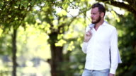 Handsome man with blazer standing outdoors video