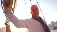 Handsome Mature man on yacht in picturesque sunset video