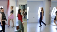 Handsome models in fashionable clothes training in catwalk in ballroom video