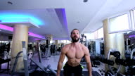 Handsome Muscular Men Performing High Intensity Bicep Curls With Barbell video